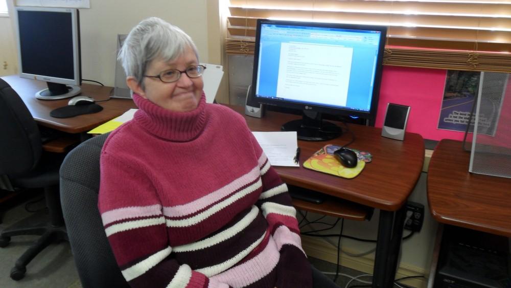 Caroline's sits at the computer desk